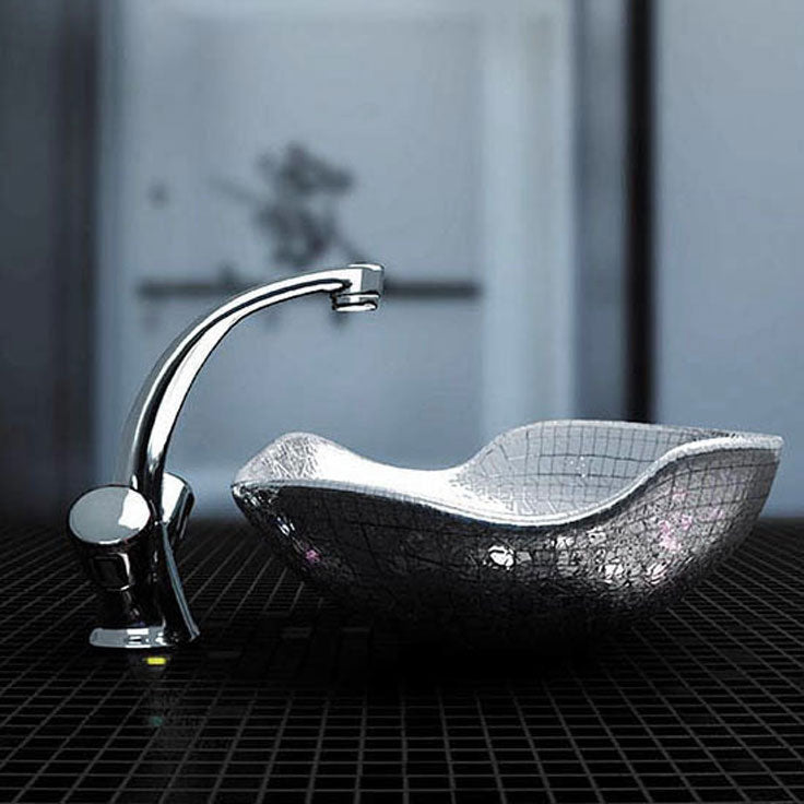 Micro mirrored tiles give this customized sink bowl a little sparkle
