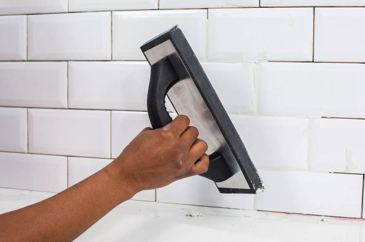 Apply new grout after removing old grout