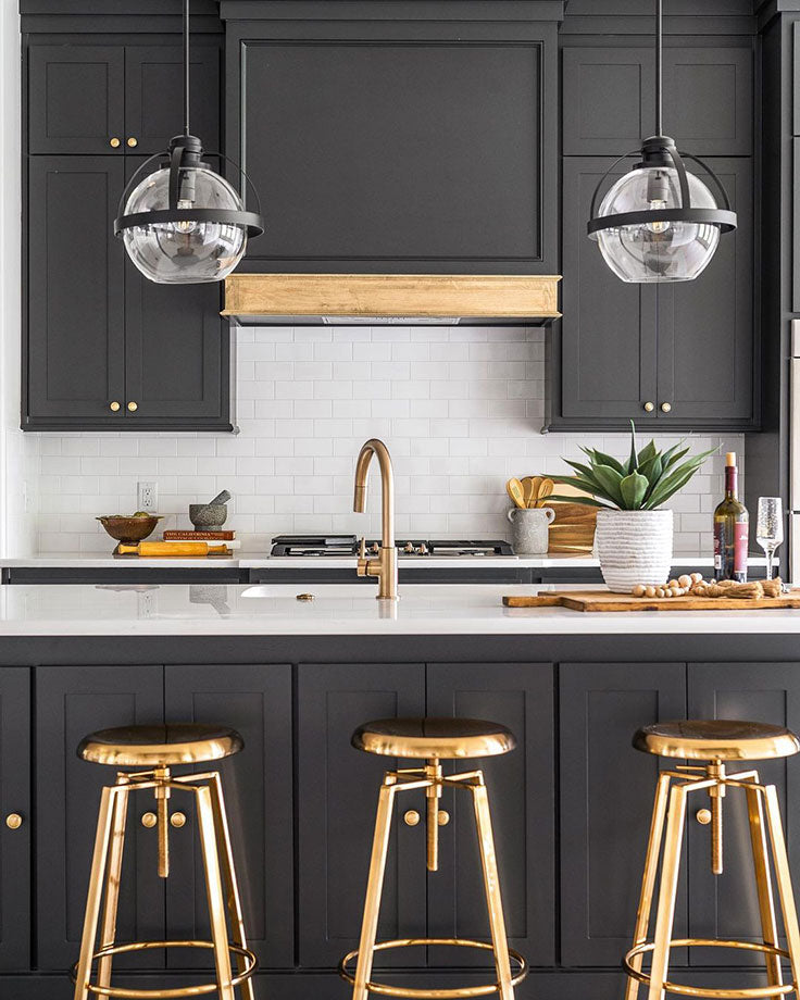 Black and Brass Kitchen with Globe Lights and White Subway Tiles