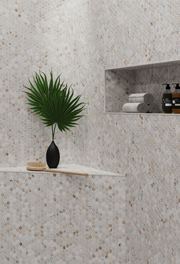 Calacatta Gold Penny Round Tiles are gorgeous on Shower Floors and Walls