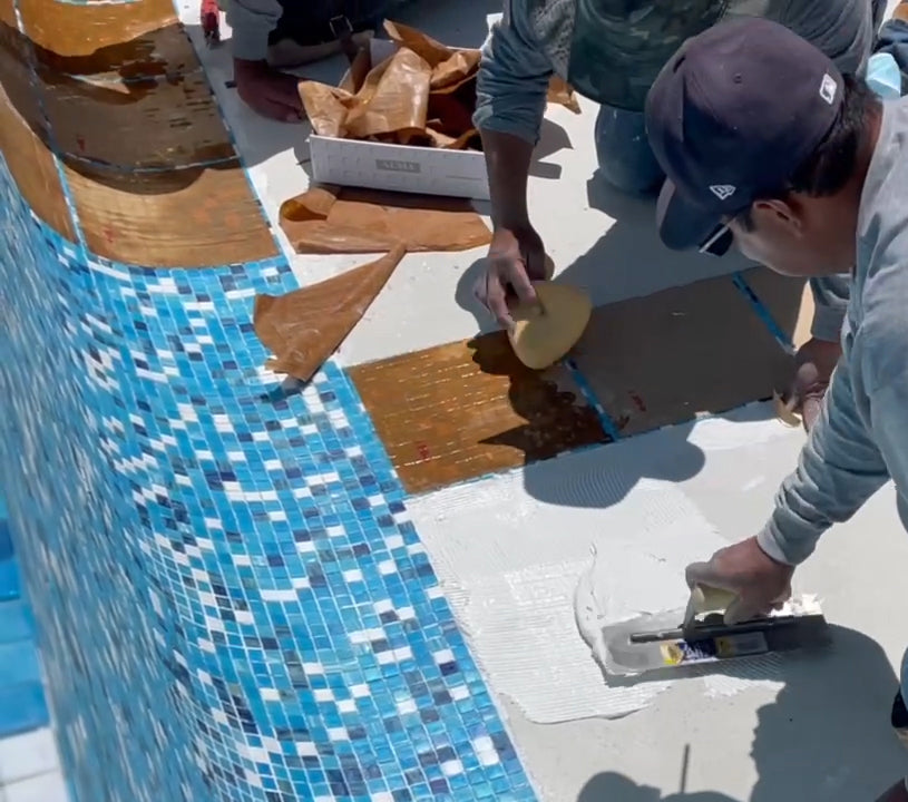 Apply thinset before placing paper faced glass mosaic tile sheets