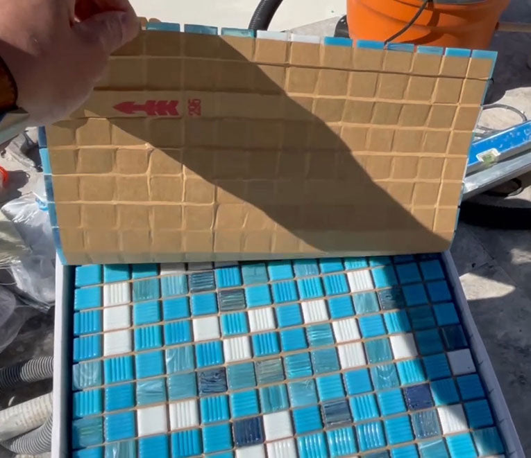 Lay out glass mosaic tiles before you install them