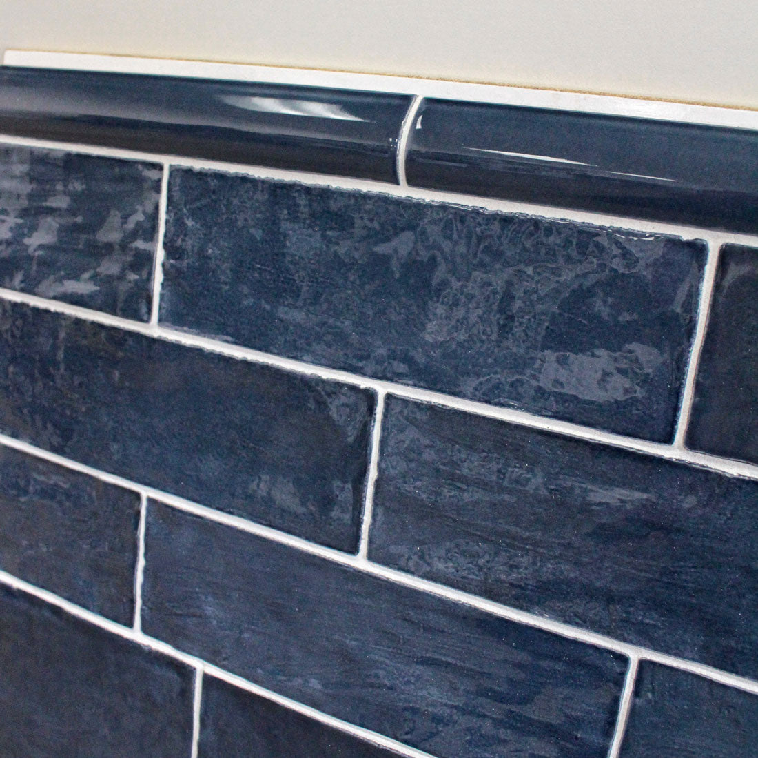 """Guide to Tile Trims and Moldings: Bullnose Tile Trim in La Riviera Blue Reef with Matching Ceramic 2.5x8"""" Subway Tile"""