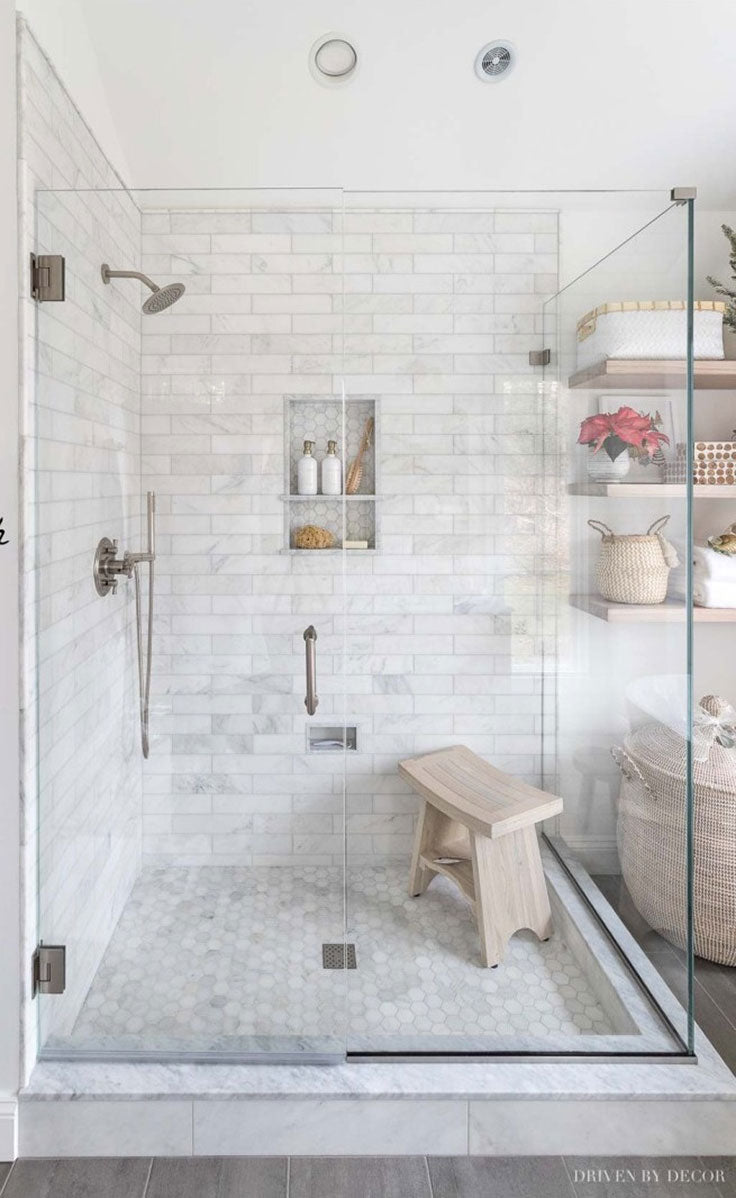 Walk In White Marble Shower with Niche and Glass Doors