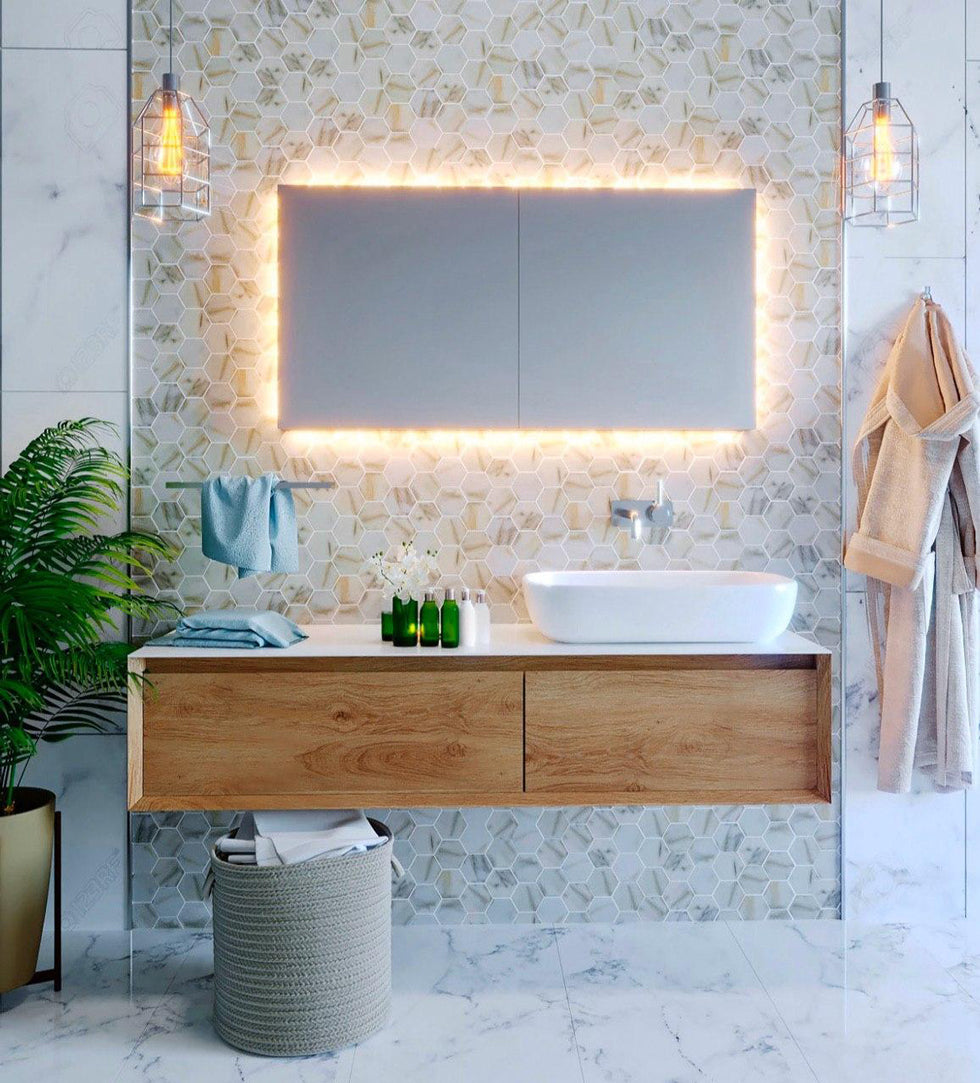 Modern Minimalist Bathroom with Floating Oak Cabinets, a Lighted Vanity Mirror, and Marble Look Hexagon Tiles Made from Recycled Glass