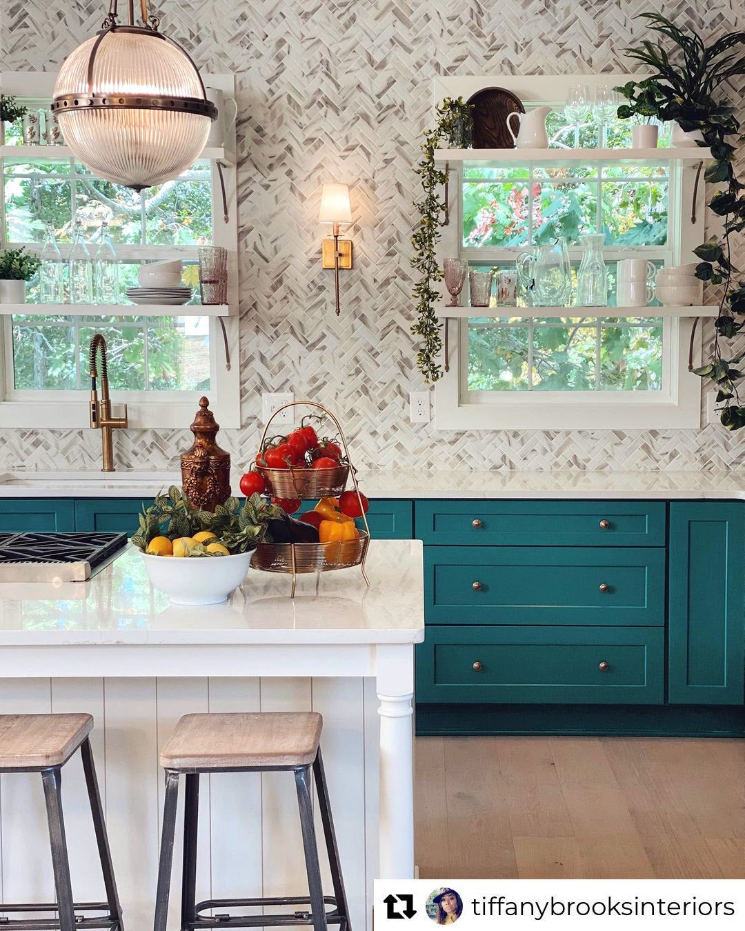 HGTV's Rock the Block with Tiffany Brooks and David Bromstad with Recycled Glass Tile in a Calacatta Gold marble pattern and bold green cabinet paint for a stunning kitchen remodeling idea!