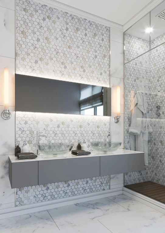 Modern geometric shapes meet timeless elegance with a Calacatta hex design for a stunning white marble bathroom!