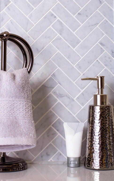 carrara herringbone tile