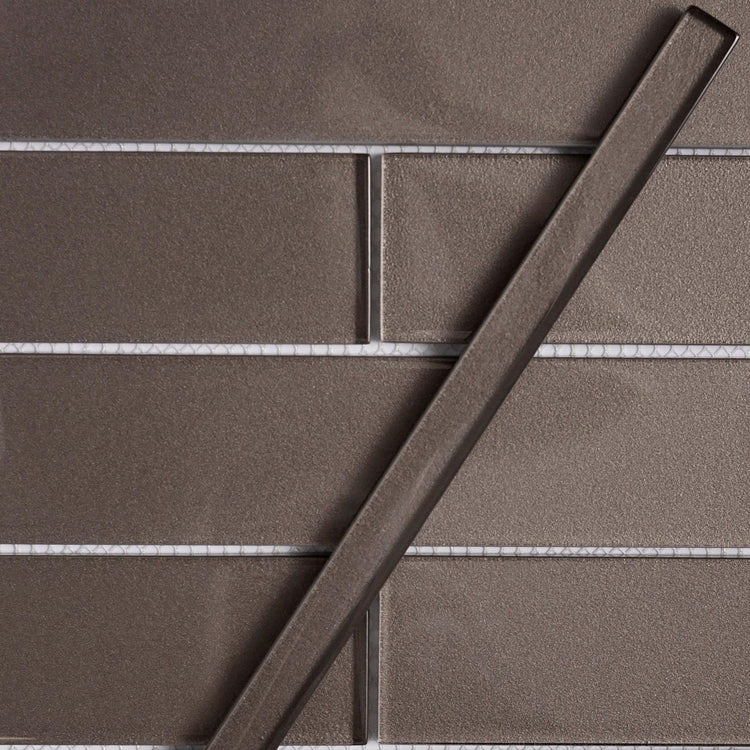 Stardust Dark Pencil Glass Molding and Tile Trim