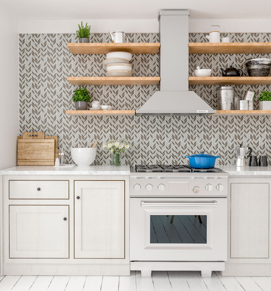 We love how this airy white cooking area brought in neutral tones with wood floating shelves and our White And Beige Mix Leaf Recycled Glass Mosaic Tile backsplash!