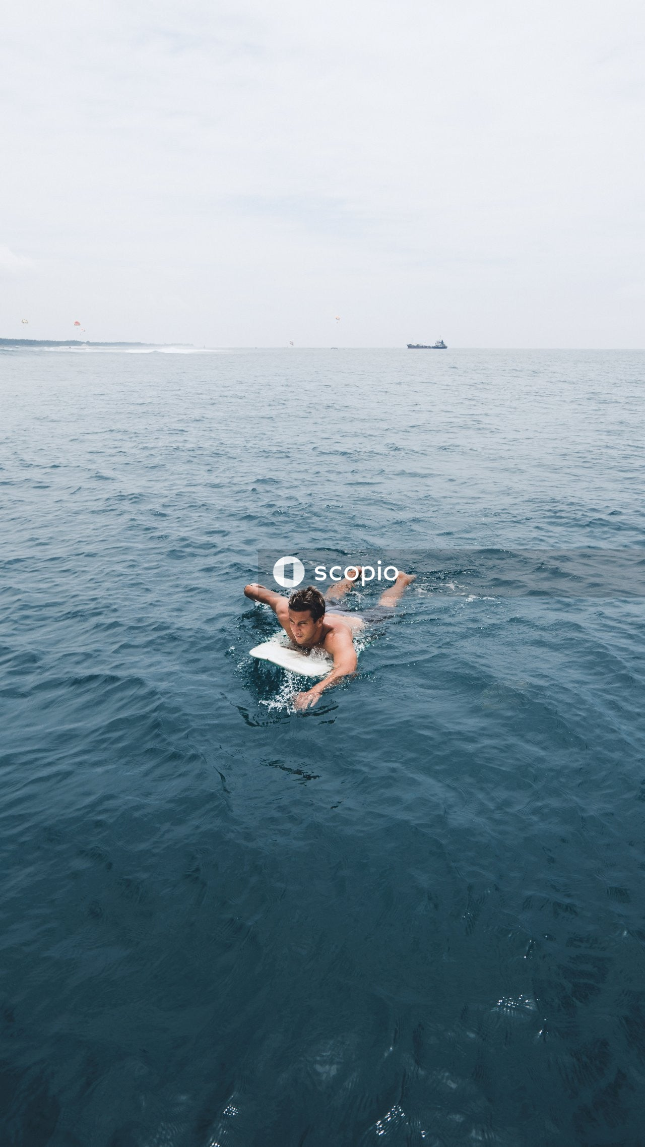 Man on surfboard in sea