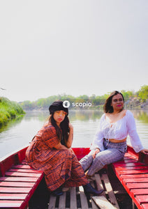 Two women sitting on boat