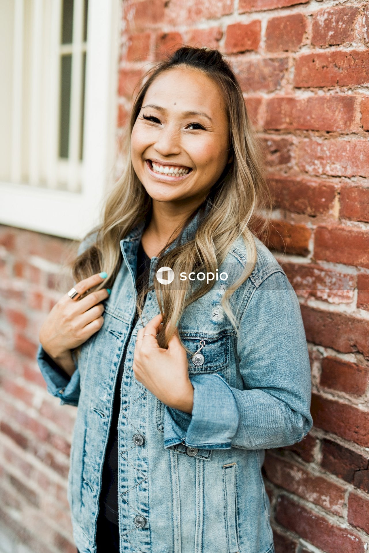 Smiling woman in blue denim jacket