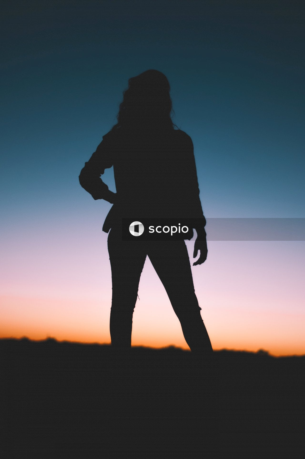 Silhouette of woman standing during sunset