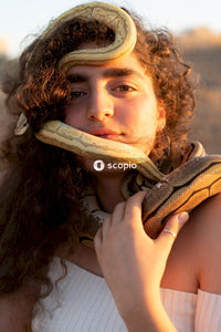 Portrait of girl with two snakes wrapped around her