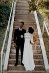 Bride and groom standing on steps