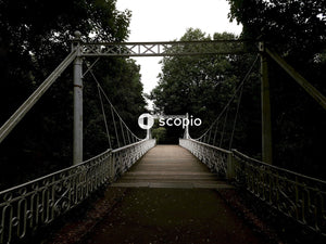 Brown wooden bridge with white rope