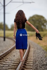 Woman walking on the train railings