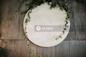 Round white base on wooden surface