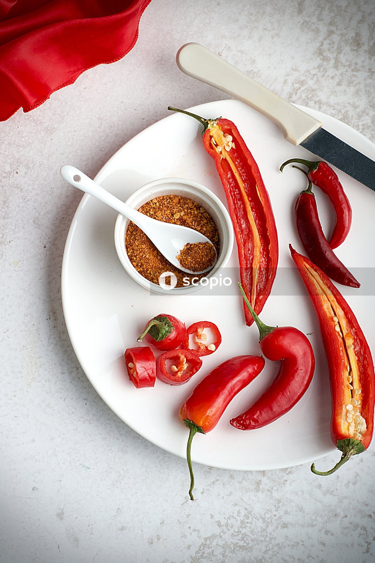 Red chili pepper on white ceramic plate
