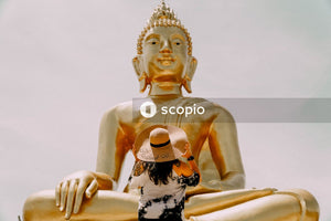 Gold buddha statue in white background