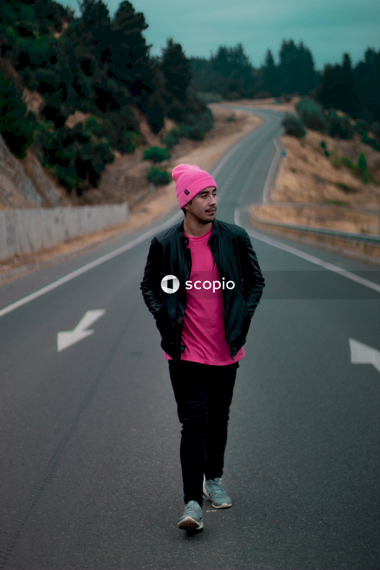 Man stands on road