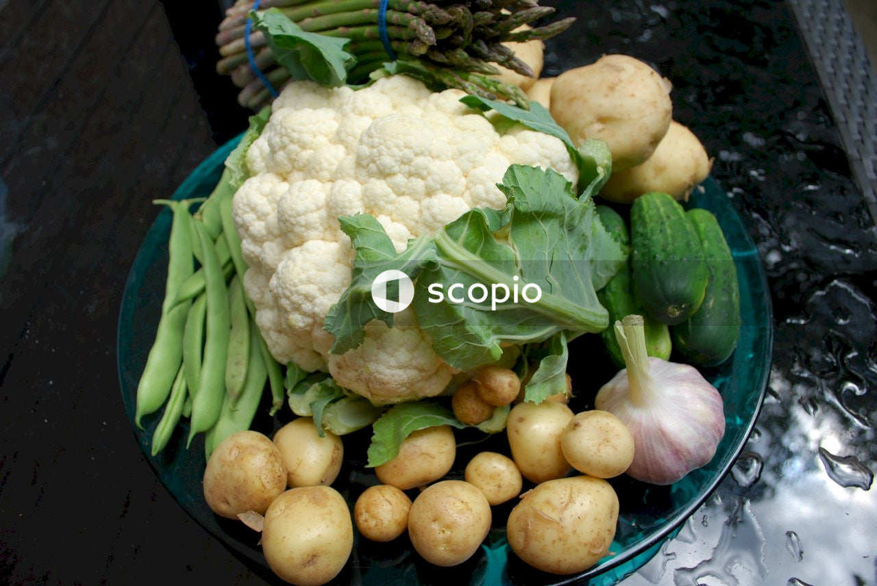 White garlic beside green vegetable