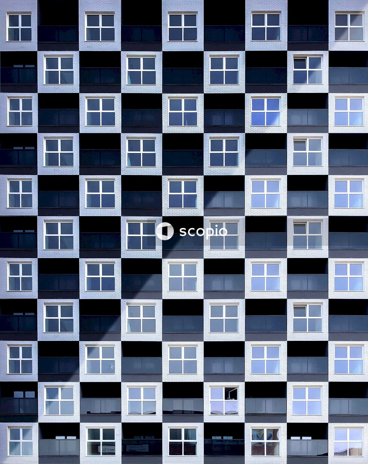 Black and white building with closed windows