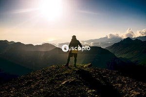Man in black jacket standing on rocky mountain