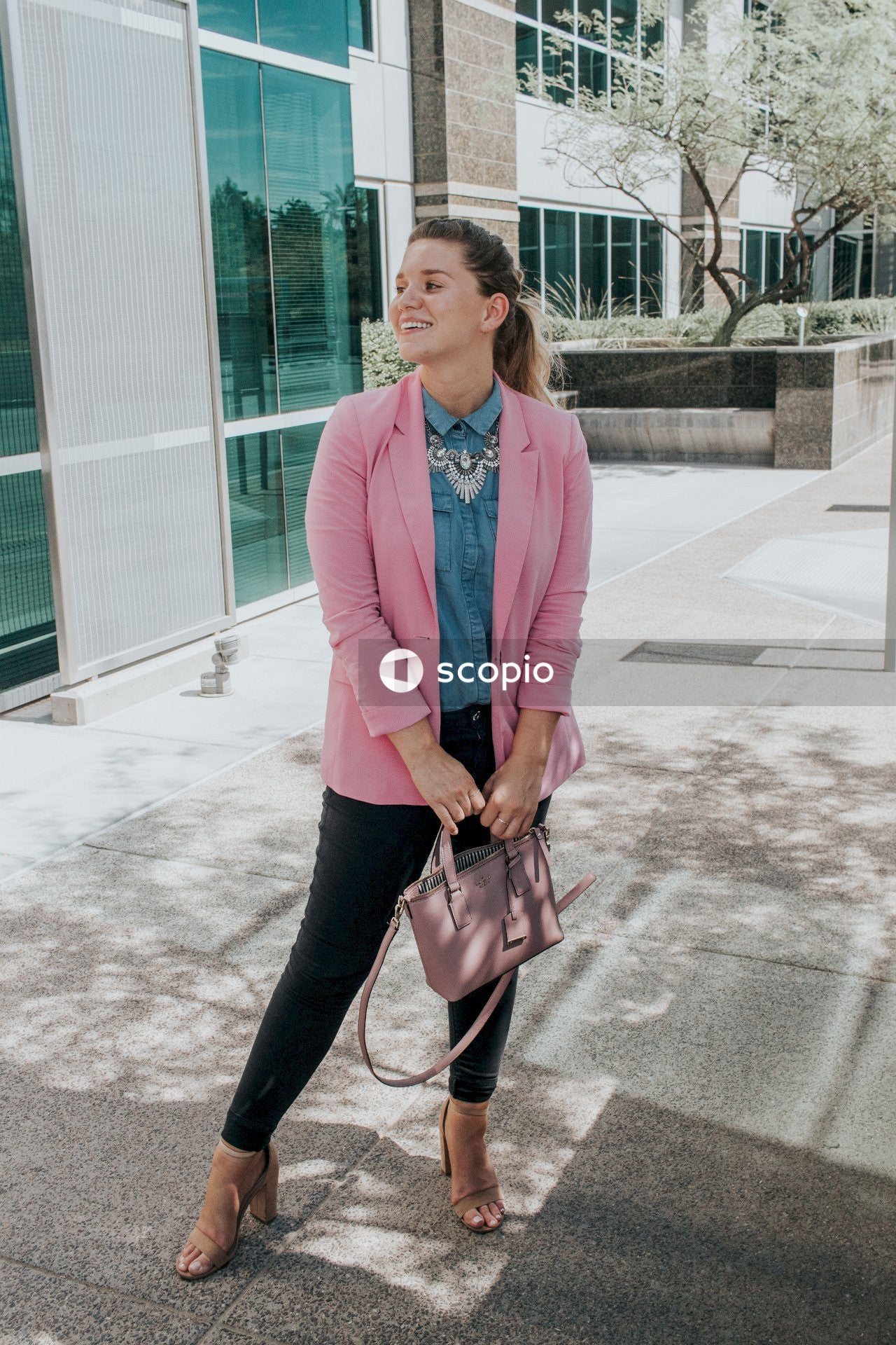 Woman in teal blazer and black pants