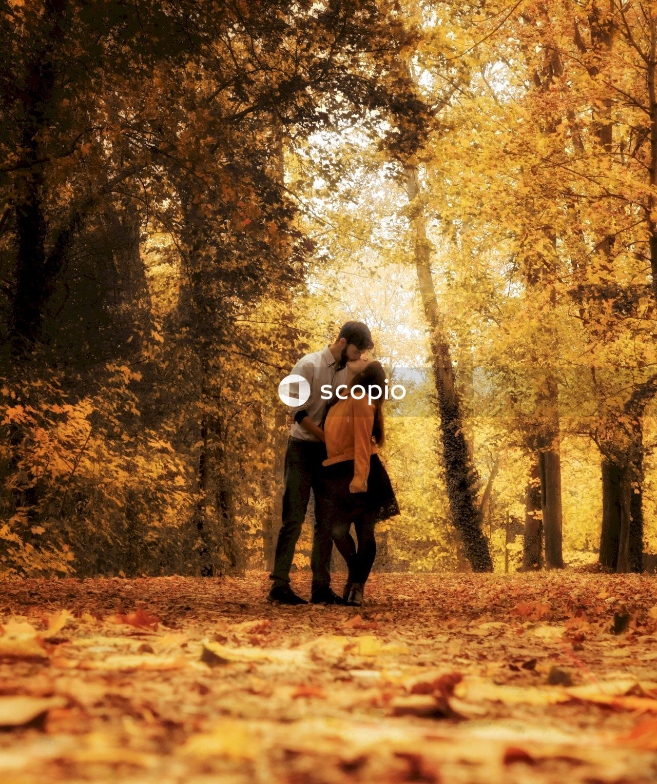 Man and woman kiss in forest
