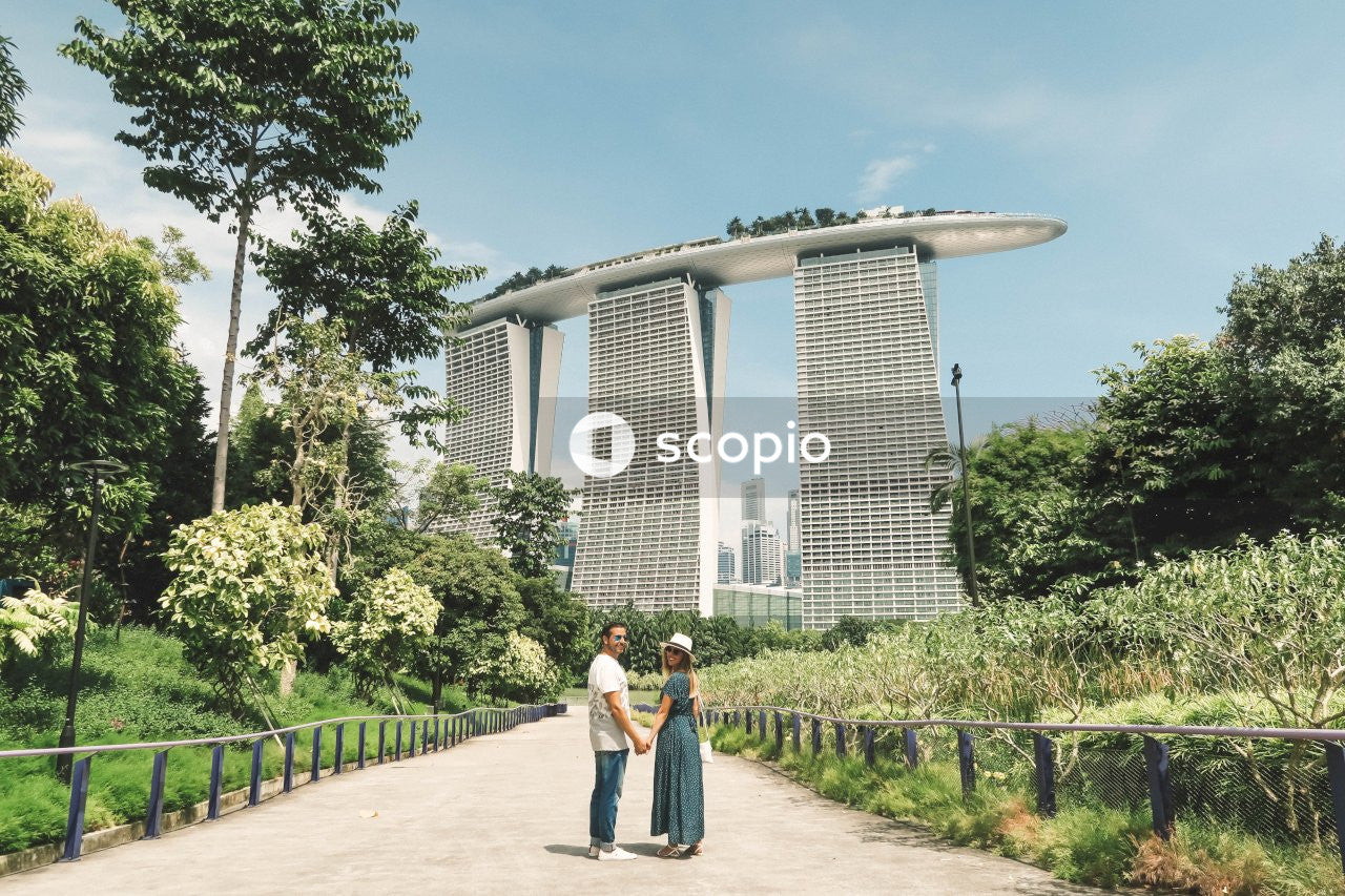 Man and woman holding hands standing near building