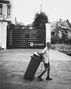 Man walking with trash can