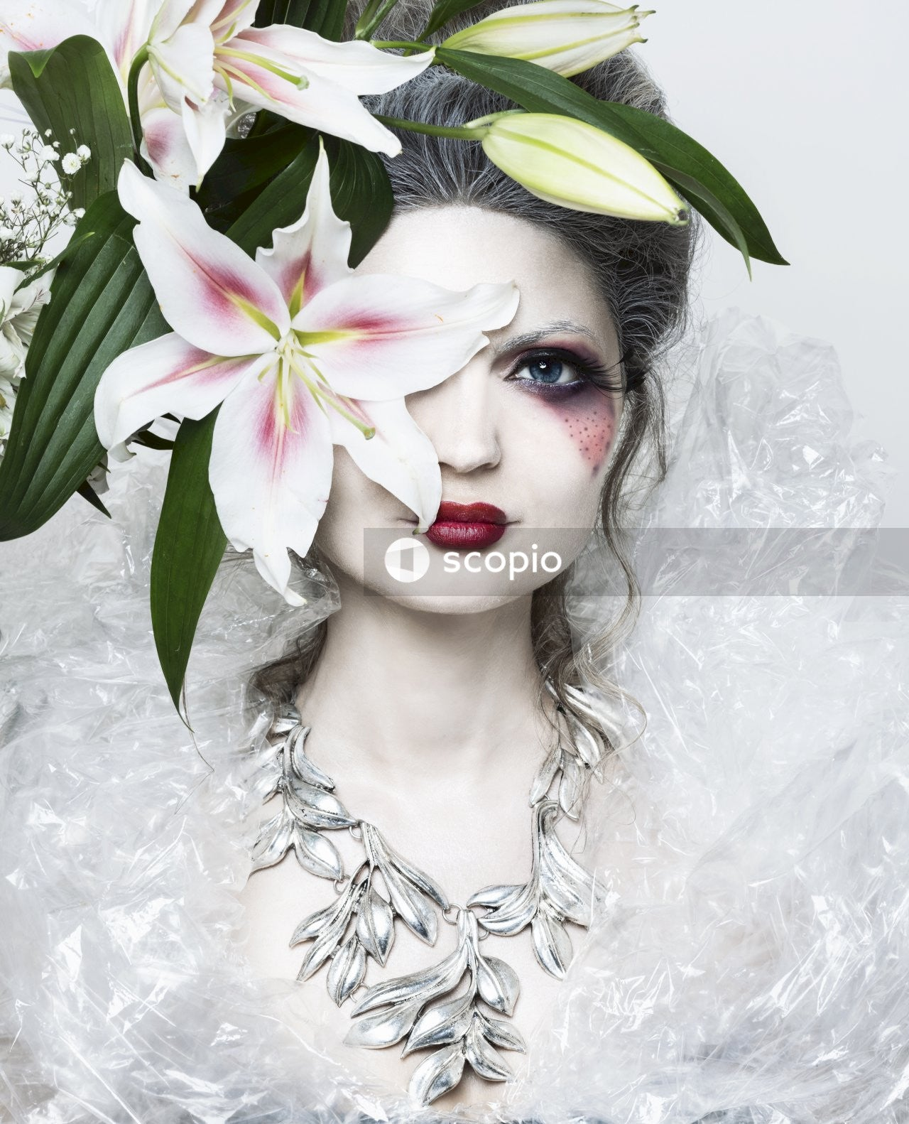 Female with makeup and flowers