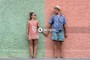 Portrait of couple next to colorful building