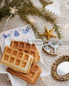 Brown waffle on white ceramic plate