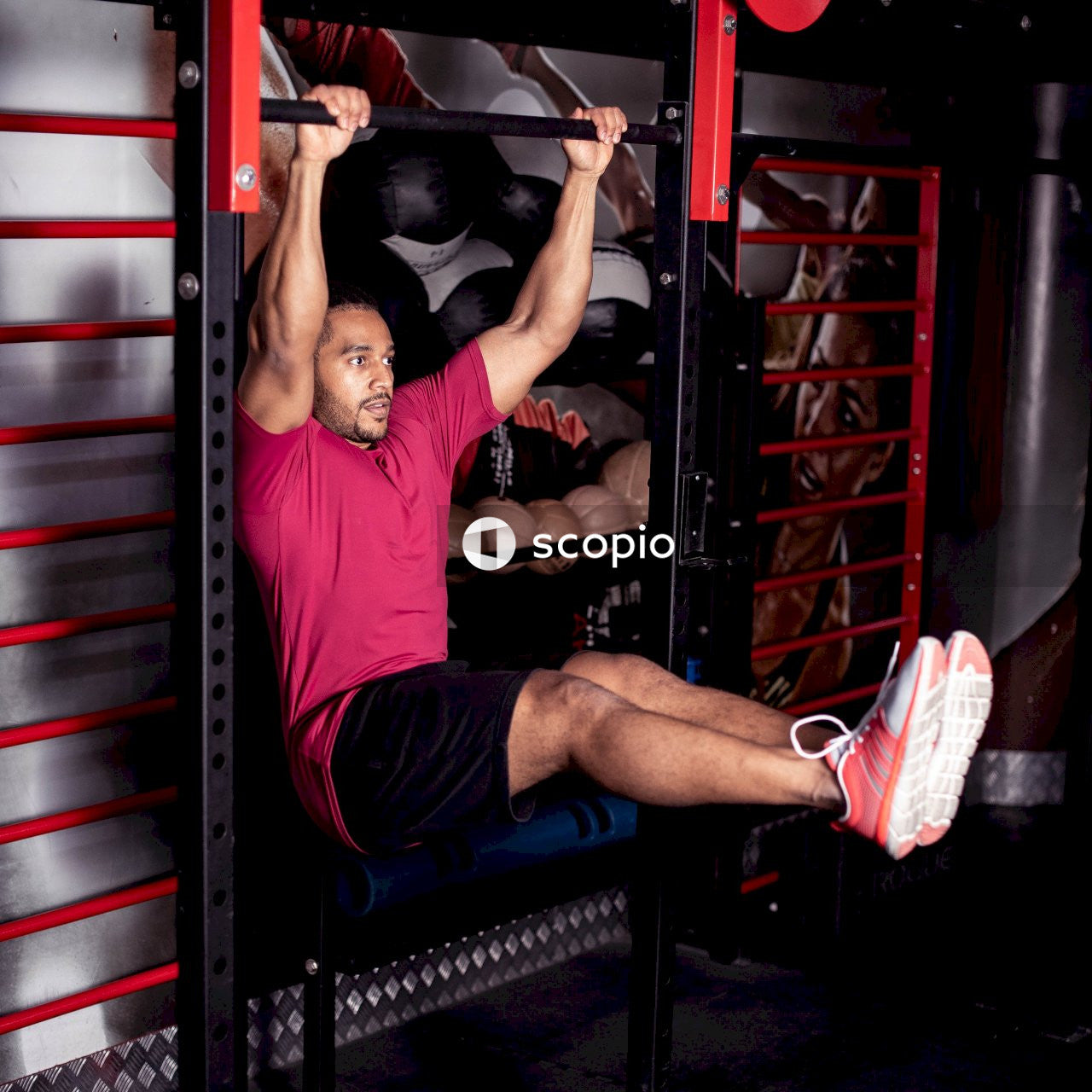 Man hanging on pull-up bar
