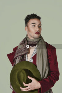 Woman in red blazer and gray scarf