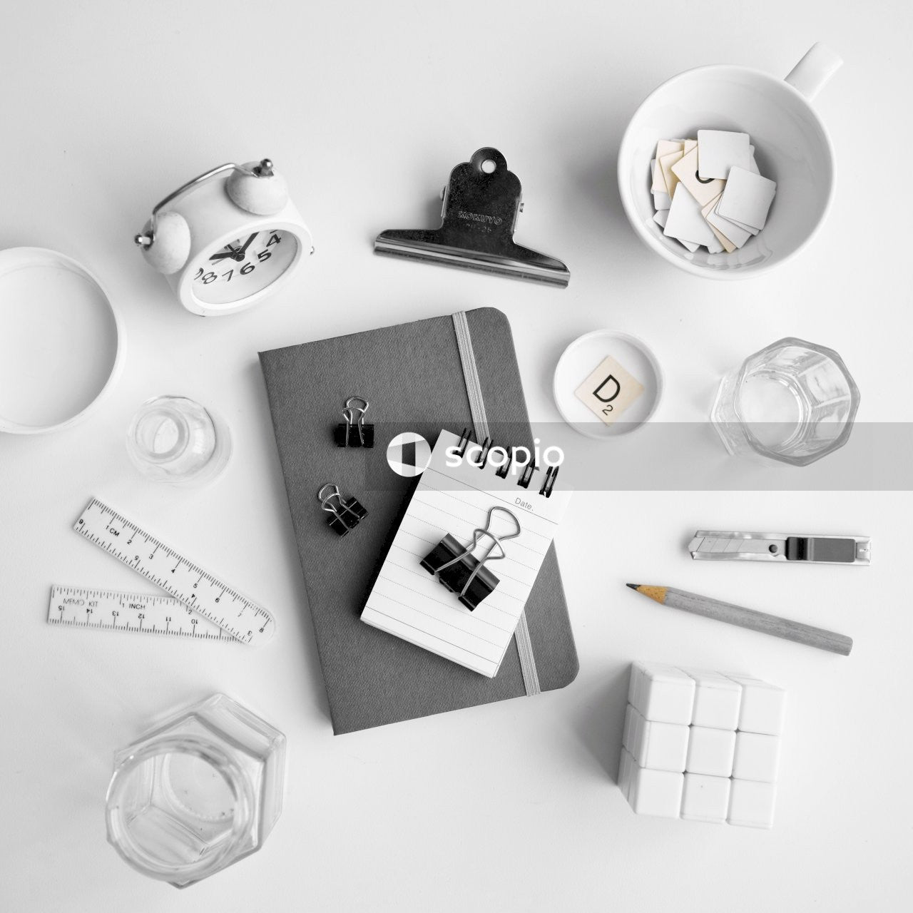 Flat lay photography of planner and other office supplies