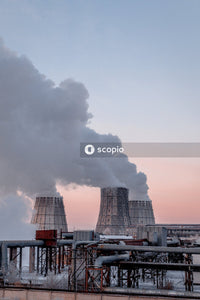 Cooling towers of power plant emitting steam on Winter morning