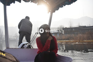 Woman sitting on boat on river