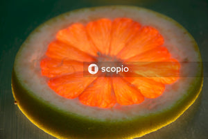 Sliced yellow citrus fruit