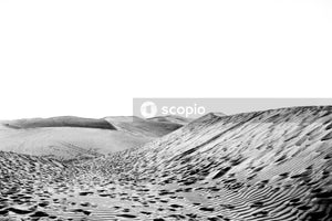 Grayscale photo of mountain ranges