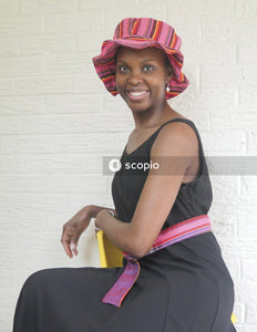 Portrait of woman wearing fancy pink hat