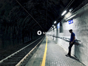 Man leaning on train tunnel wall