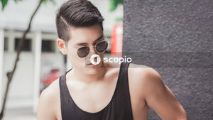 Man in black tank top wearing sunglasses