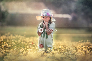 Girl stands near flower plants