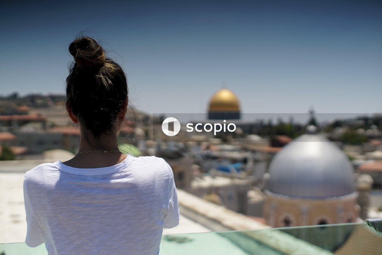 Woman looking at the al-aqsa mosque in the old city of jerusalem