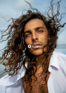 Portrait photography of man with long curly hair