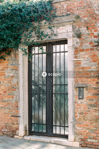 Closed black security french doors